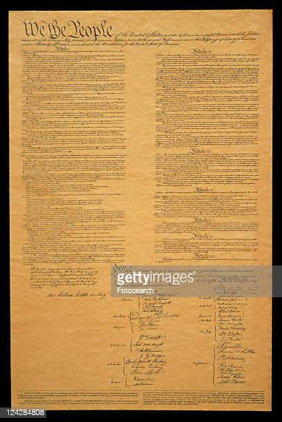 this shows the entire original u.s. constitution on its faded parchment paper - bill of rights stock photos and pictures