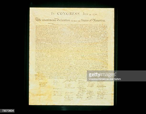 this shows the original declaration of independence in its entirety written on its now faded parchment paper. - declaration of independence stock pictures, royalty-free photos & images