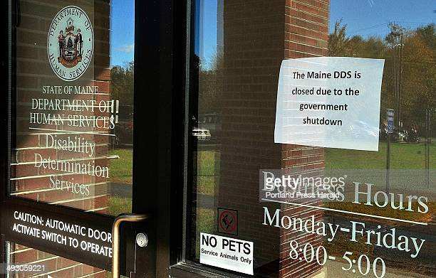 This sign in the window announces that Department of Health and Human Services Disability Determination Services office is closed due to federal...