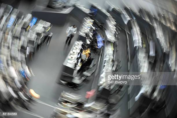 This slow shutter effect photograph shows traders waiting as the Indonesian Stock Exchange closed their trading activities in Jakarta on October 9...