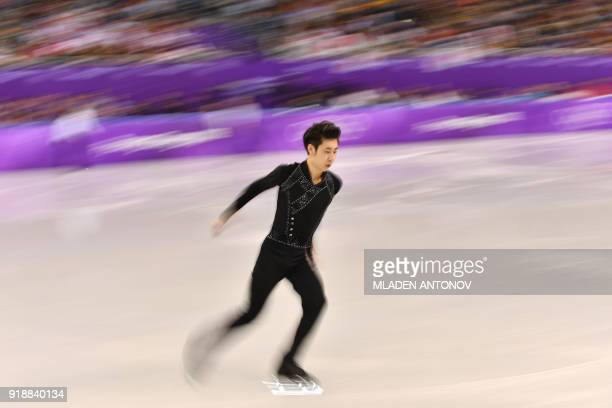 This slow shutter speed exposure shows China's Jin Boyang warming up before competing in the men's single skating short program of the figure skating...