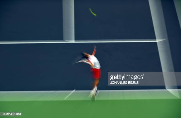 TOPSHOT This slow shutter speed exposure shows Novak Djokovic of Serbia serving against Alexander Zverev of Germany in their men's singles semifinal...