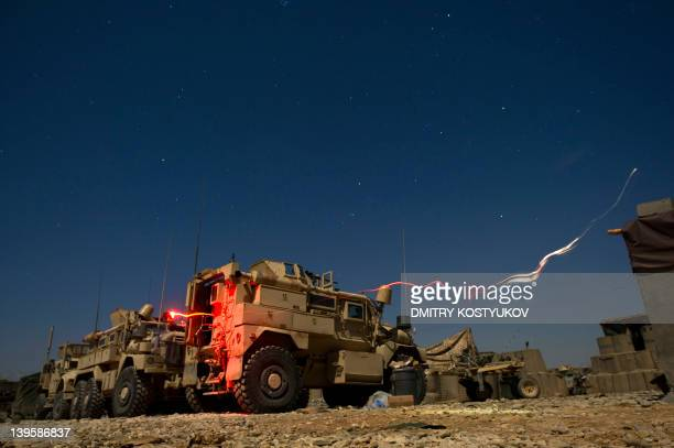 This slow shutter speed exposure shows US armoured vehicles of the US Marine 1st Battalion 8th Bravo company at Talibjhan base in Musa Qala district...
