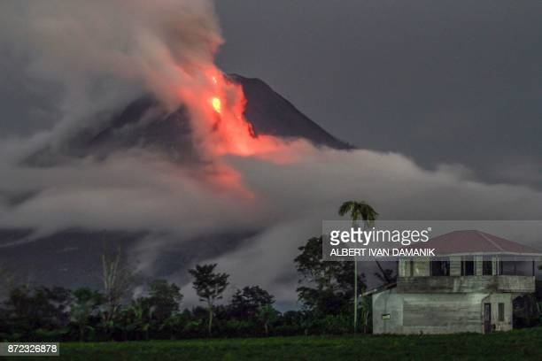 TOPSHOT This slowshutter speed photograph shows the eruption of Mount Sinabung volcano as seen from Simpang Ampat village in Karo North Sumatra on...