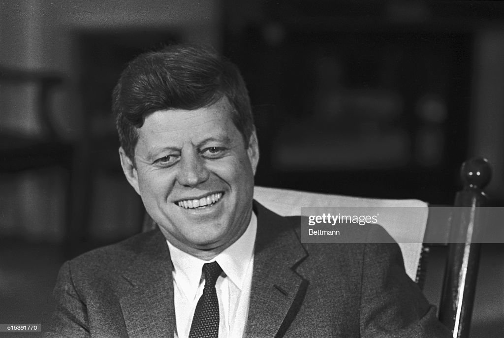 This smiling close-up of President Kennedy was made at the White House on the eve of his 46th birthday, which he plans to celebrate with a quiet dinner party tomorrow at the White House. Picture was made while Kennedy was meeting with Netherlands Foreign Minister Luns.