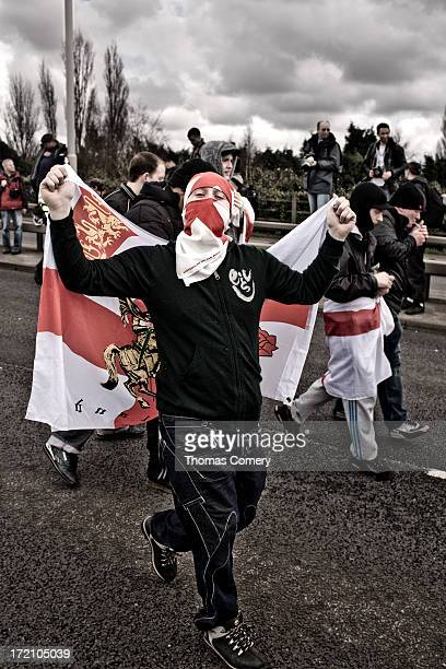 This social documentary image of an English Defense League protester holding a Saint George's flag at a demonstration held on the 3rd of April 20120...