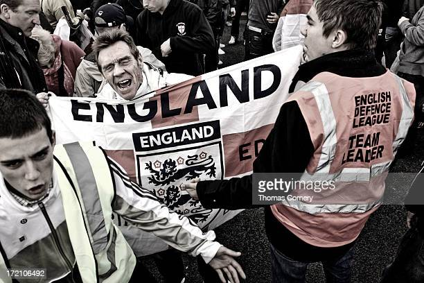 CONTENT] This social documentary image of an English Defense League protester holding a Saint George's flag at a demonstration held on the 3rd of...
