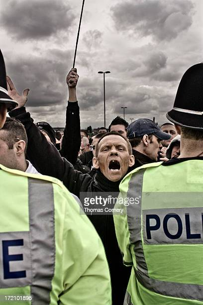 CONTENT] This social documentary photograph looks at the contrast between the English Defense League demonstrators and police It was taken in Dudley...