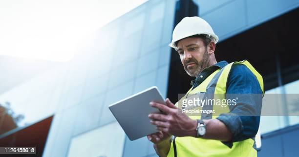 this software help me to keep track of everything - building contractor stock pictures, royalty-free photos & images