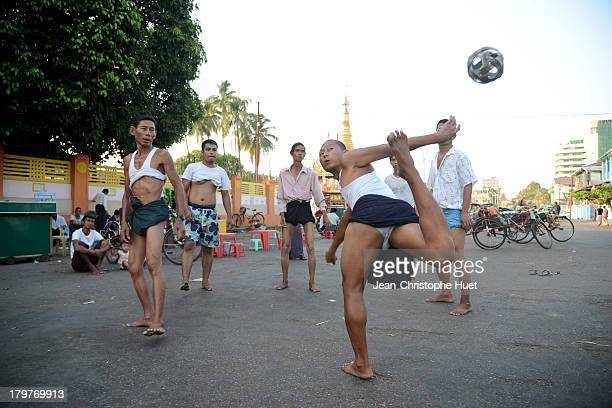 """This sport, called """"chinlon""""is very popular in Myanmar. 6 men, in circle, play with a rattan ball. They can use the whole body, except hands and arms."""