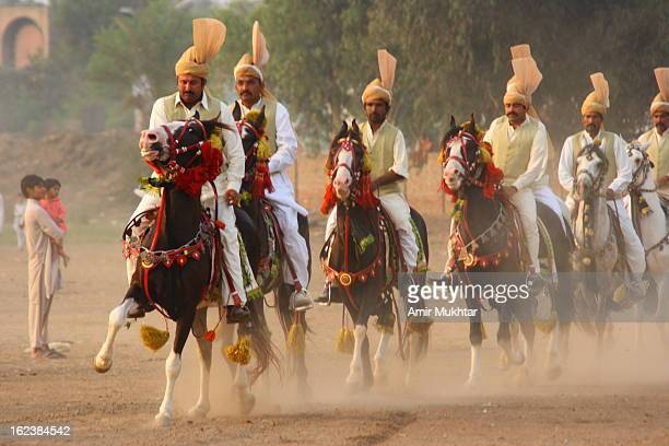 This sport is very popular in the rural areas of Pakistan. It is a game / sport of brave people. In this game player / rider pick the peg with lancer...