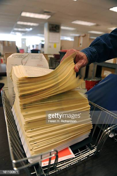 This stack of claims represents just a single morning's worth of new claims that have arrived in the mail Nationwide and in Colorado the number of...