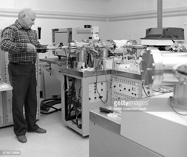 This staged photograph depicts Louis Alexander in the Toxicology Mass Spectrometry Lab working with a mass spectrometer device 1989 Mass...