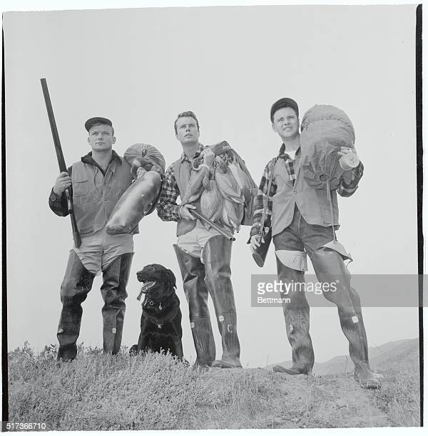 This star studded duck hunting team pauses to survey the terrain trying to find a good location Left to right are Aldo Ray Robert Francis and Jack...
