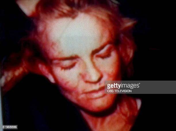 This still frame taken from a television broadcast shows 31 January 1995 a photograph of Nicole Brown Simpson entered into evidence at the OJ Simpson...