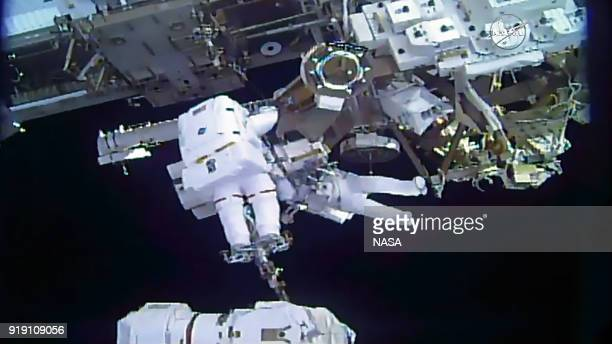 This still image from video courtesy of NASA shows spacewalkers Mark Vande Hei of the US and Norishige Kanai of Japan transferring a spare robotic...