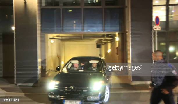 This still image taken from an AFP video made on March 21 shows a car transporting former French president Nicolas Sarkozy leaving a police building...