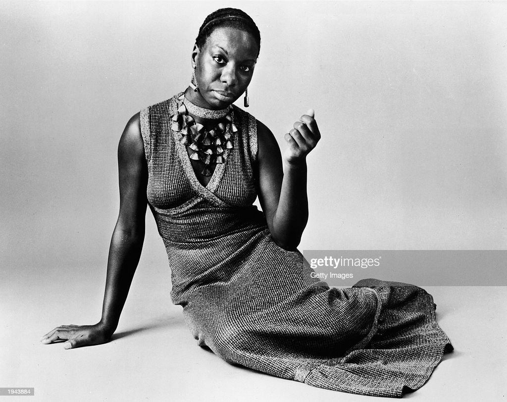 This studio portrait shows American pianist and jazz singer Nina Simone reclining on the floor circa 1968. Simone, whose deep, raspy voice made her a unique jazz figure and later helped chronicle the civil rights movement, died in her sleep on April 21, 2003 of natural causes after a long illness. She was 70.
