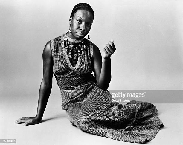 This studio portrait shows American pianist and jazz singer Nina Simone reclining on the floor circa 1968 Simone whose deep raspy voice made her a...