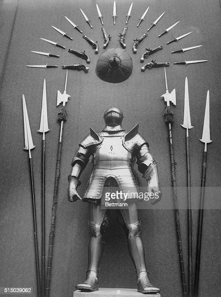 This suit of armor and surrounding weaponry date from the time of Henry VIII.