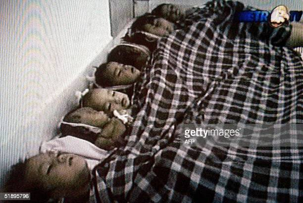 This television grab taken 27 December 2004 shows the dead bodies of Indonesian children who were killed in Aceh the day before after a massive 90...