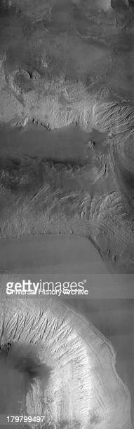 This THEMIS visible image shows the effects of erosion on a beautiful sequence of dramatically layered rocks within Candor Chasma which is part of...