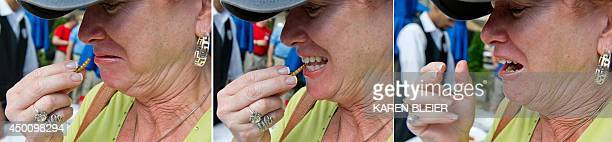 This three picture combo shows a patron reacting as she eats a mealworm June 4 2014 during a global Pestaurant event sponsored by Ehrlich Pest...