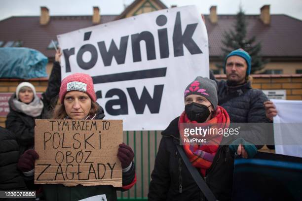 This time it s polish death camp banner seen during Mothers to the Border protest organized near Border Guards outpost against inhumane treatment of...