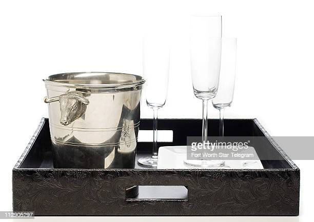 This tooled leatherbound tray is as useful as it is handsome $47 PS The Letter wwwpsthelettercom Add a pewter bullandbear motif ice bucket $262...
