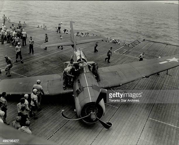 This torpedo bomber crashed as it came aboard after returning from a raid on one of Japan's heavily bombed cities It crumpled up its propeller when...