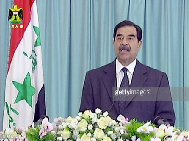 This TV grab from Baghdad's official television shows Iraqi President Saddam Hussein addressing the nation on the 11th annivesary of the Gulf War The...