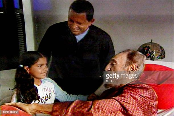 This TV grab from the stateowned Cuban television shows Venezuelan President Hugo Chavez smiling as his daughter greets Cuban leader Fidel Castro in...