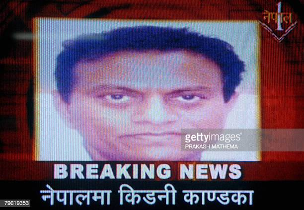 This TV grab taken from Nepal One Television channel in Kathmandu on February 7 2008 shows a Portrait of Dr Amit Kumar the alleged mastermind of an...