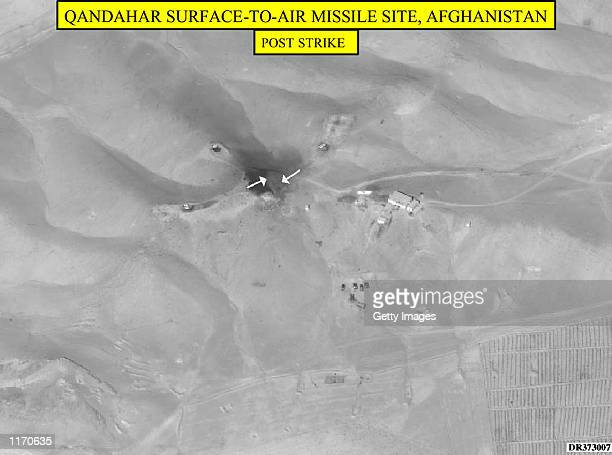 This undated Department of Defense photograph released October 9, 2001 shows damage to the Qandahar surface-to-air missile site in Afghanistan after...
