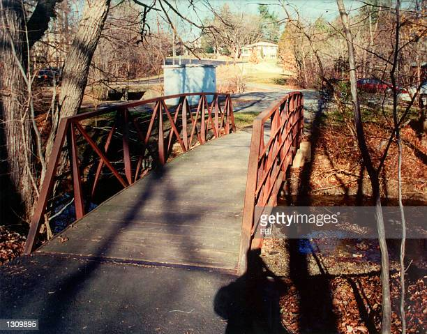 This undated file photo released by the FBI February 20 2001 shows the footbridge over Wolftrap Creek near Creek Crossing Road at Foxstone Park near...