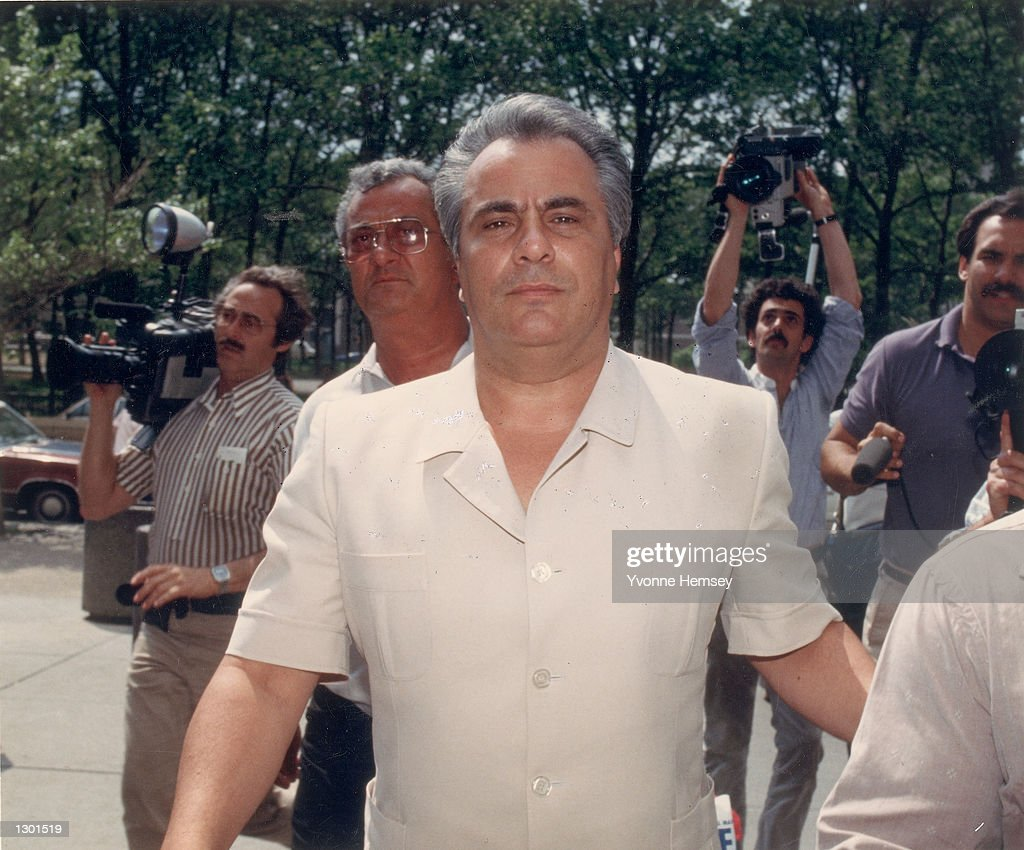 This undated file photo shows Mafia Boss John Gotti, aka 'The Dapper Don,' arriving at a courthouse for his hearing, as the media follows in New York City. Doctors at the Federal Prison Hospital in Springfield, MO., announced on June 6, 2001 that Gotti was losing his battle with throat cancer and was expected to die in the coming weeks.
