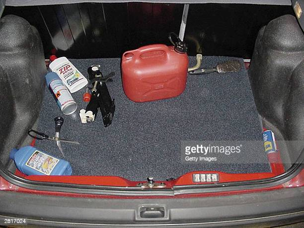 This undated handout photo shows a pair scissors and a petrol container in the boot of Ian Huntley's car Huntley was found guilty of the murder of...