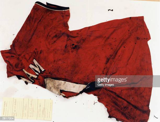 This undated handout photo shows the burnt remains of the red Manchester United shirts belonging to the two murdered ten year old girls Holly Wells...