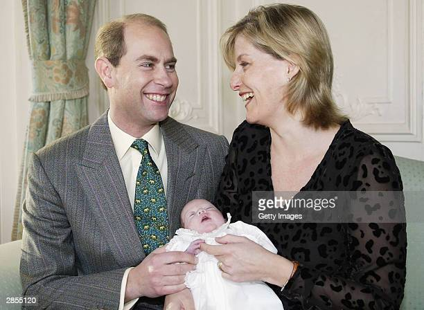 This undated handout photo shows The Earl and Countess of Wessex holding their newborn daughter, Lady Louise Windsor, who was born prematurely in...