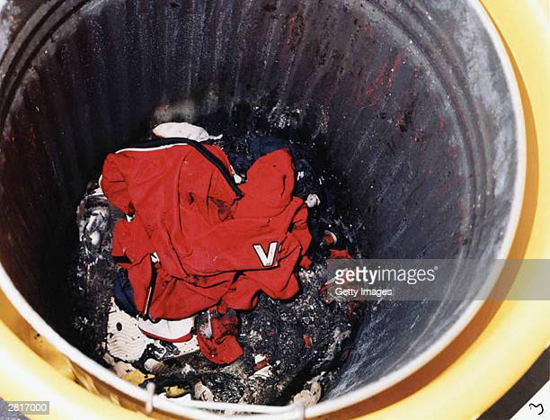 This undated handout photo shows the litter bin in which burnt remains of the Manchester United shirts belonging to the two murdered ten year old...