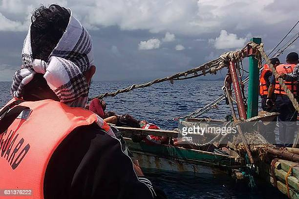 CORRECTION This undated photo received on January 10 2017 shows Philippine coast guard personnel inspecting a fishing boat of which its crew were...