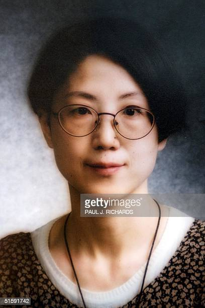 This undated photo released 21 March 2001 shows Gao Zhan a sociology professor at the American University in Washington DC Gao her husband Xue...