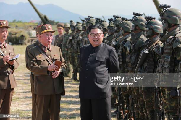 This undated photo released by North Korea's official Korean Central News Agency on August 26 2017 shows North Korean leader Kim JongUn presiding...