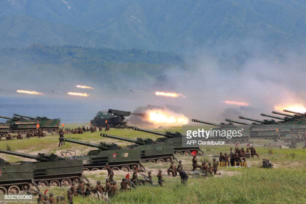 TOPSHOT This undated photo released by North Korea's official Korean Central News Agency on August 26 2017 shows rockets being launched by Korean...