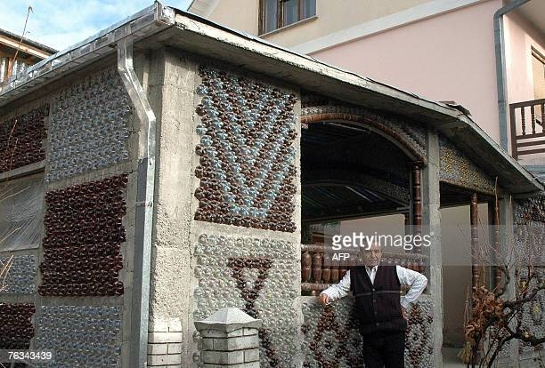 This undated photo shows physics professor Tomislav Radovanovic standing in front of his house, built with plastic bottles 27 August 2007, in...