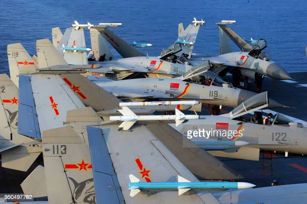 This undated photo taken in April 2018 shows J15 fighter jets on China's sole operational aircraft carrier, the Liaoning, during a drill at sea. - A...
