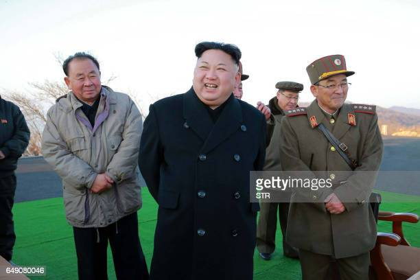 This undated picture released by North Korea's Korean Central News Agency via KNS on March 7 2017 shows North Korean leader Kim JongUn supervising...