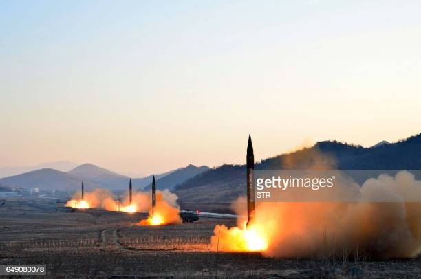 TOPSHOT This undated picture released by North Korea's Korean Central News Agency via KNS on March 7 2017 shows the launch of four ballistic missiles...