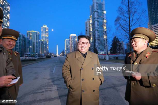 This undated picture released by North Korea's official Korean Central News Agency on March 16 2017 shows North Korean leader Kim JongUn visiting...