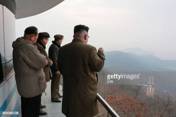 TOPSHOT This undated picture released by North Korea's official Korean Central News Agency on March 19 2017 shows North Korean leader Kim JongUn...